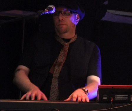 Keith Weir playing keyboards with The Quireboys