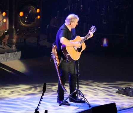 Alex Lifeson playing acoustic guitar