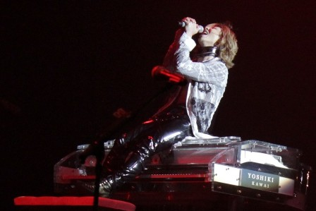 Yoshiki seating on his piano