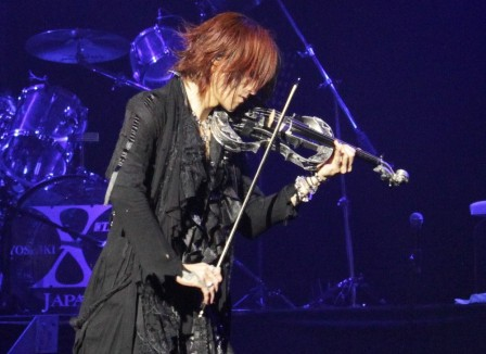 Sugizo playing violin with X Japan